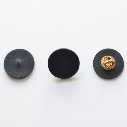 Noir d'Orion pin's rond noir - dos