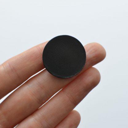 Noir d'Orion pin's rond noir